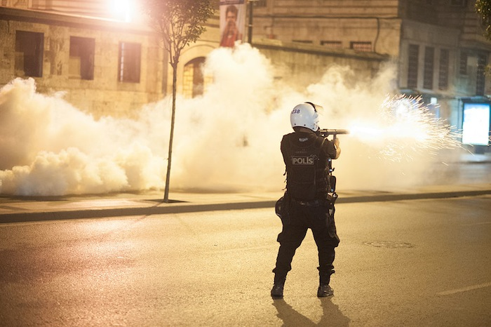 Riot police officer in action during Gezi park protests in Istanbul, June 16, 2013. (Credit: Mstyslav Chernov via Wikimedia)