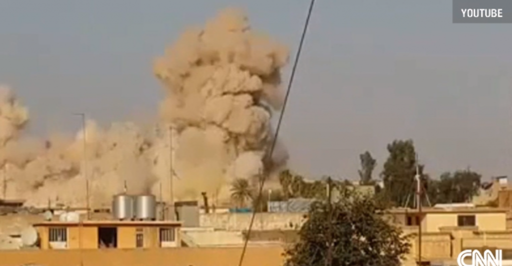 Video still seconds after detonation of the minaret and building complex. Watch