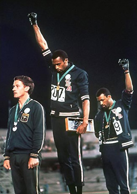 Tommie Smith, John Carlos, and Peter Norman protest American and Australian White Supremacist policies, October 16, 1968, Mexico City Olympics. (AP Photographer via Wikimedia)