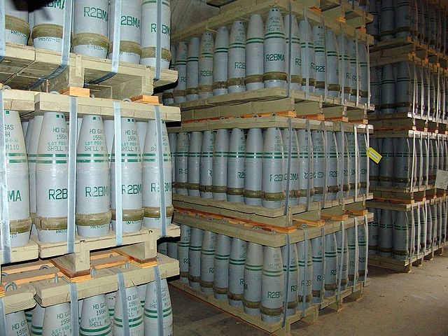 "Pallets of 155 mm artillery shells containing ""HD"" (distilled sulfur mustard agent) at Pueblo Depot Activity (PUDA) chemical weapons storage facility. (Credit: US Army via Wikipedia.) Similar shells, made in Europe before the first Gulf War, were found in Iraq by US forces."