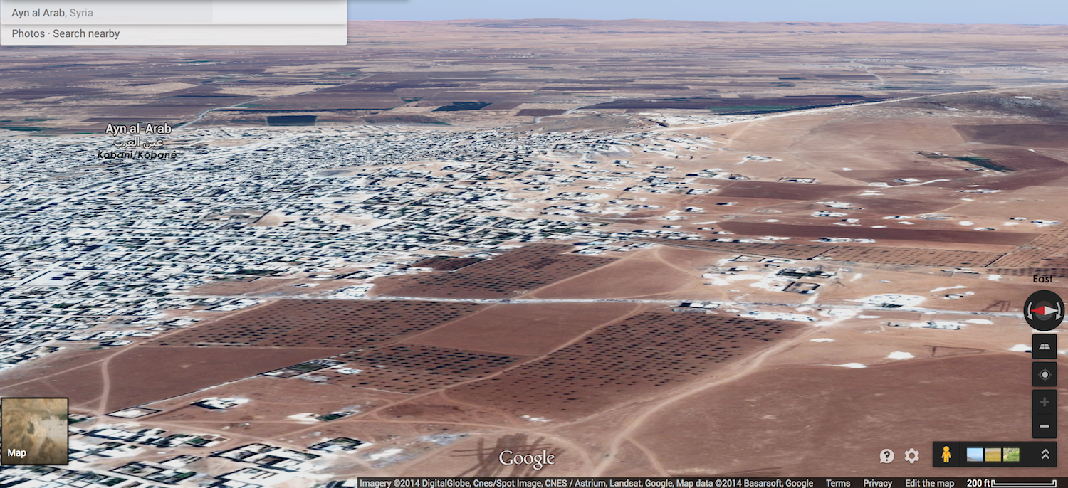 Labeled digital rendering, looking eastward, of Kobani / Ayn Al-Arab, Syria, October 5, 2014. ISIS captured the hill on the right, allowing it to shell the town center Click map to enlarge or click here to navigate in Google Maps.