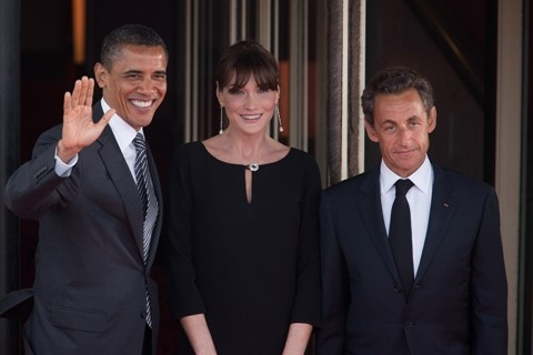Pictured: President Barack Obama is greeted by French President Nicholas Sarkozy and his wife Carla Bruni at the G8 Summit dinner in Deauville, France, May 26, 2011. (White House Photo)