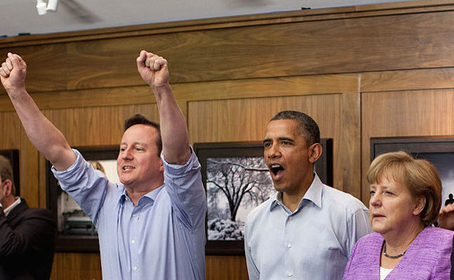 Pictured: Prime Minister David Cameron, President Barack Obama, and Chancellor Angela Merkel, May 2012, watching a Chelsea vs. Munich soccer match during the G8 summit. (White House Photo)