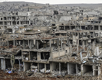 A low-res close crop of the destruction inside Kobani, stretching toward the horizon, captured by AFP's Bulent Kilic. Full image at IB Times.