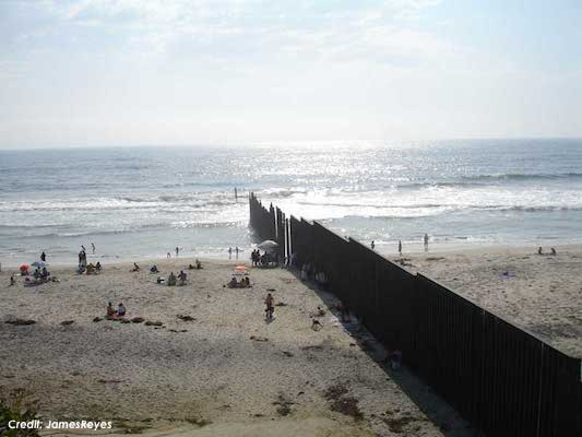 US-Mexico border fence at Tijuana and San Diego by the Pacific Ocean. (Credit: JamesReyes)