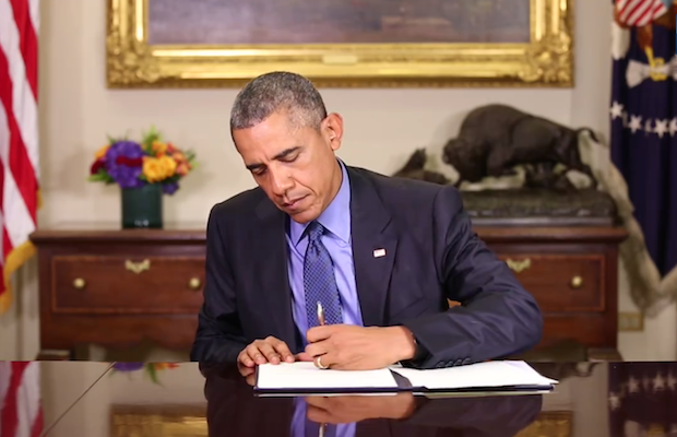 Barack Obama signing clemency grants to convicted non-violent drug offenders with disproportionate sentences, July 2015. (Credit: The White House)