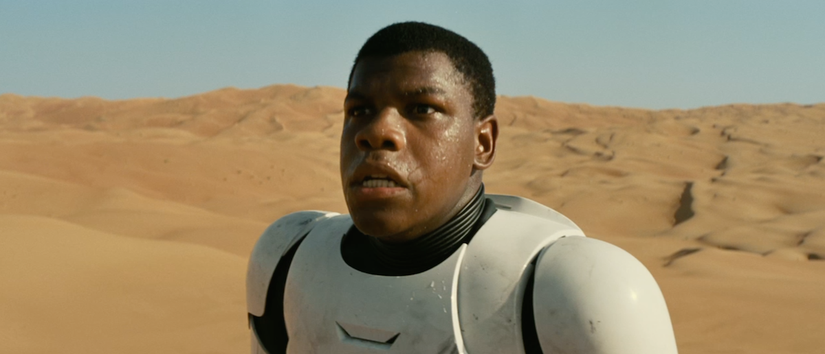 "John Boyega in Stormtrooper armor in the November 2014 trailer for ""Star Wars: The Force Awakens."""
