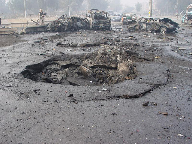 Pictured: A December 2007 suicide car bombing in Baghdad during the surge. (Credit: Jim Gordon via Wikimedia)