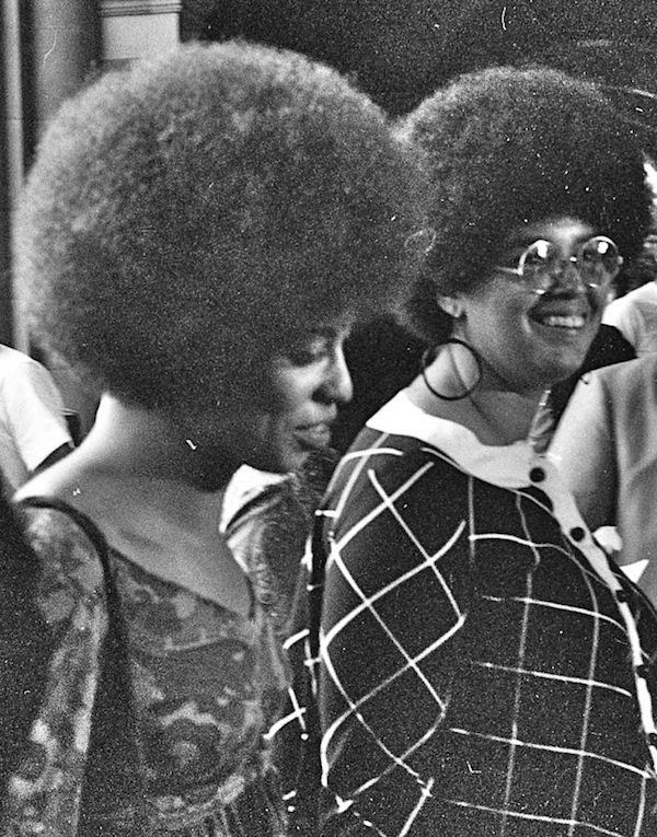 Angela Davis (left) and another woman with afros in 1969 at UCLA. (Photo Credit: George Louis via Wikimedia)
