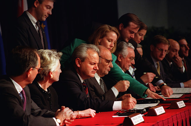 President Slobodan Milosevic of the Federal Republic of Yugoslavia, President Alija Izetbegovic of the Republic of Bosnia and Herzegovina, and President Franjo Tudjman of the Republic of Croatia initial the Dayton Peace Accords at Wright-Patterson Air Force Base Nov. 1-21, 1995. (Photo Credit: U.S. Air Force.)